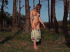 Innocent girl posing in nature