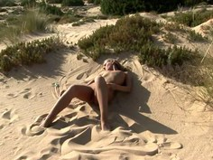 Hot blonde doing sand angels
