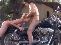 Holly fucks him on his bike