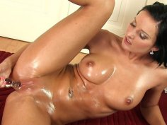 Oiled brunette charmer Niky Peach fuck glass dildo from behind