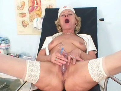 Blond granny nurse using gyno pussy spreader