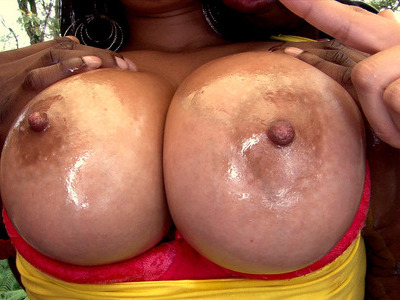 Caramel colored skin babe Juliana shows off her juicy melons