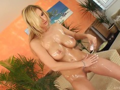 Heavy chested blonde Carol plays with glass dildo