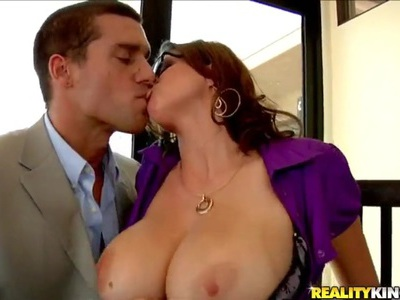 Ramon Nomar gets sucked by top heavy milf Sarah