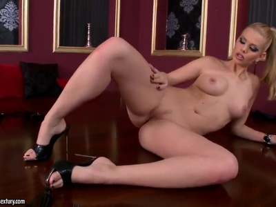 Leggy beauty stripping and caressing twat