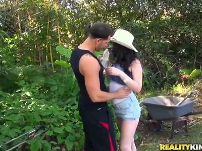 Busty babe enjoys in sucking a hard rod in the back yard