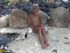 Sweet-looking blonde girl is banged on a beach