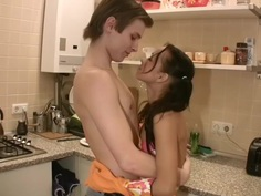 Young girl fucked by young boy in kitchen.