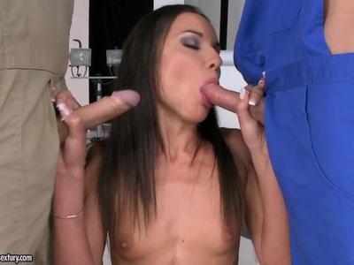 Slutty babe feasting on two ridged cocks