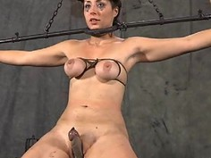 Tied up slave gets pleasuring her wicked twat
