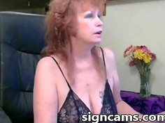 Nasty blonde granny strips of clothes and shows pussy
