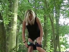 Amateur babe squatting and pissing in the woods