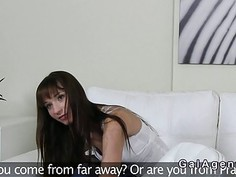 Female agent fucks tall lesbian with strap on toy