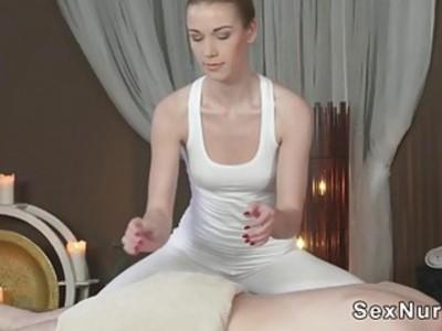 Brunette masseuse gives cock massage
