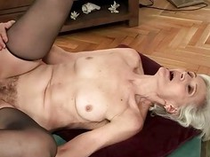 Granny in black stockings fucking with a boy