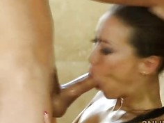Horny therapist massages clients dick with her throat