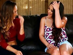 Two hot babes massage each others pussies on the couch