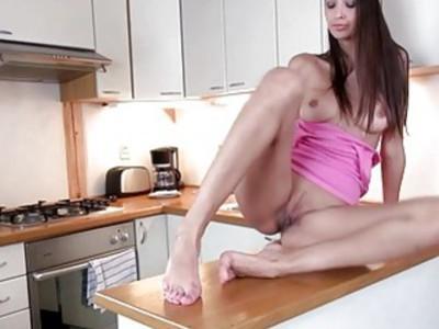 shocking brunette in the kitchen