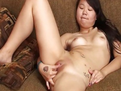 Cute dark haired slut from Asia fingering her cunt