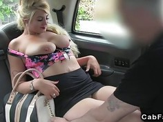 Busty blonde giving tits job in fake taxi