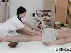 Busty masseuse gives footjob
