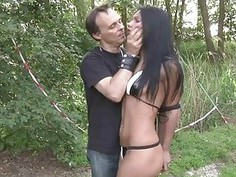Slave suspension in the woods and bondage fuck
