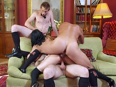 Brunette feasted on with three fat cocks