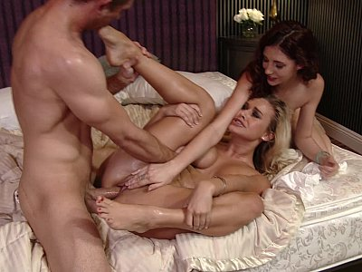 Hot girlfriends sharing a cock in amusing threesome