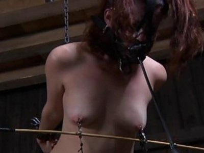 Bounded beauty is leaking from her sexy torture
