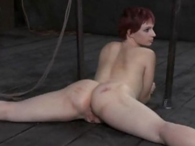 Caged girl gets a whipping for her smooth wazoo