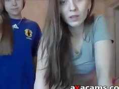 Two cute looking teens undressing on webcam