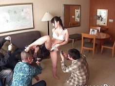 Horny Japanese skank spreads her legs for these freaks