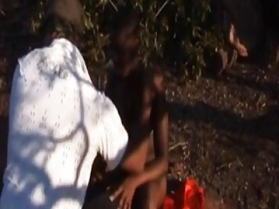Outdoor bondage and deepthroat with a busty African slut