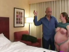 A horny doctor fucks lusty pregnant brunette woman's pussy on the bed