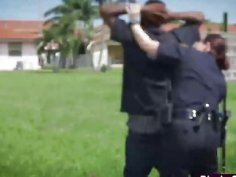 Two nasty police officers sharing black cock outdoors