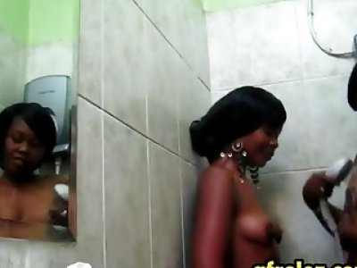 Wet African babes Maxi and Sajeda make love in bathroom