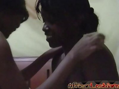 Busty African babes fingering pussies in bedroom