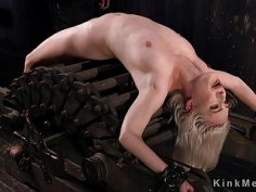 Blonde flogged in back arched position