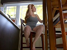 Redhead housewife doing herself on a chair