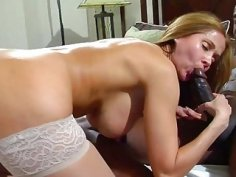 Tempting MILF swallows down a black monster and gets smashed
