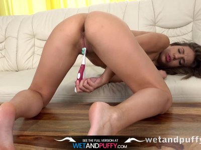 Orgasm  Russian babe Lilly teases her pussy with an electric toothbrush