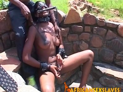 Ebony babe gets tortured outdoors
