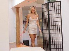 Leggy blonde using a vibrator