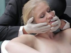 BDSM fantasy of Avril Hall with masked man in tuxedo