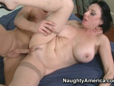 Busty mature brunette whore Karen Kougar fucks young stud.