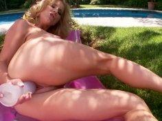 Blonde goddess Ainsley Addison pokes her twat on air mattress