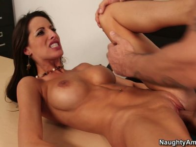 Busty and slutty teacher Kortney Kane rides a cock on the desk