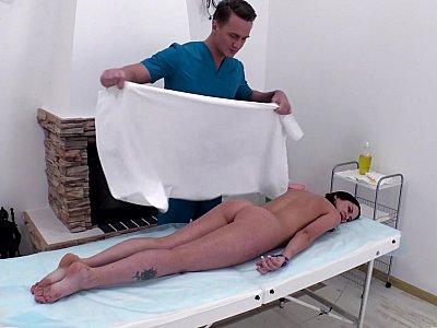 Oily brunette teased during massage