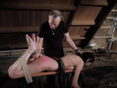 Submissive brunette in suspension bondage gets whi