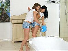 Steamy lesbian sex in a bathtub